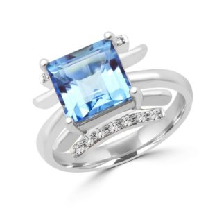 Emerald cut blue topaz & diamond cocktail ring in 10k white gold