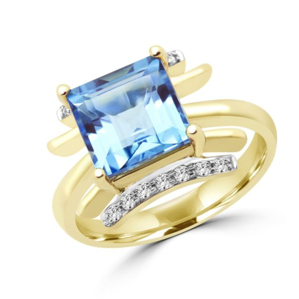 Emerald cut blue topaz & diamond cocktail ring in 10k yellow gold