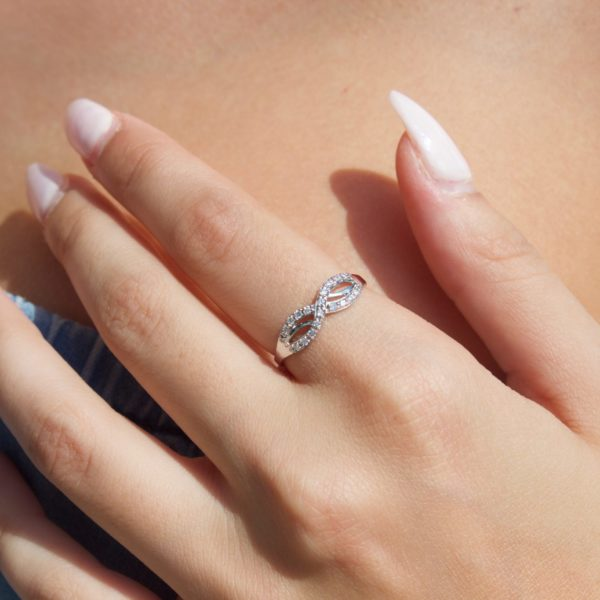 Diamond accent infinity fashion ring in 14k white gold