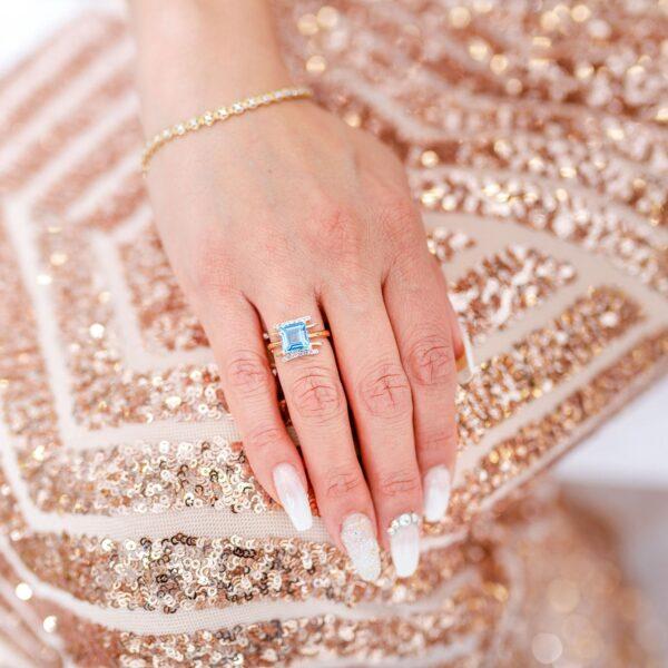 Emerald cut blue topaz & diamond cocktail ring in 10k white gold