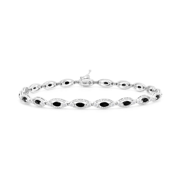 Diamonds & oval cut sapphire bracelet in 14k white gold